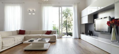 Modern living room with wood floor overlooking the garden